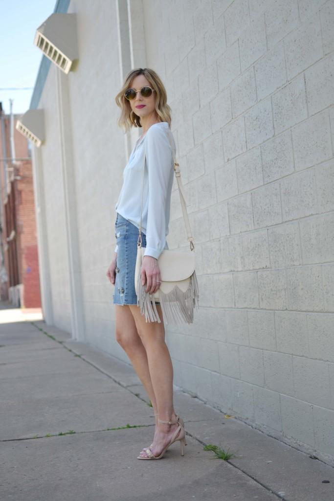 jean skirt, blue blouse, fringe bag, round sunglasses 4
