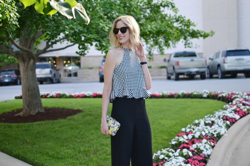 gingham top, black culottes, floral clutch