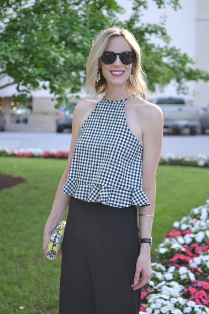 gingham top, black culottes, floral clutch, statement earrings