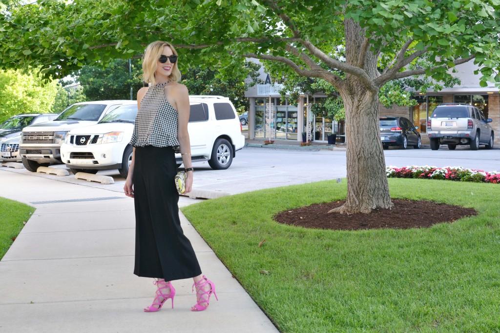 gingham top, black culottes, pink heels, floral clutch