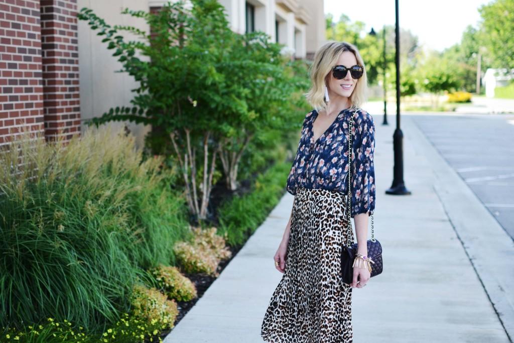 Pleione printed blouse, leopard skirt, Rebecca Minkoff bag, Karen Walker sunglasses