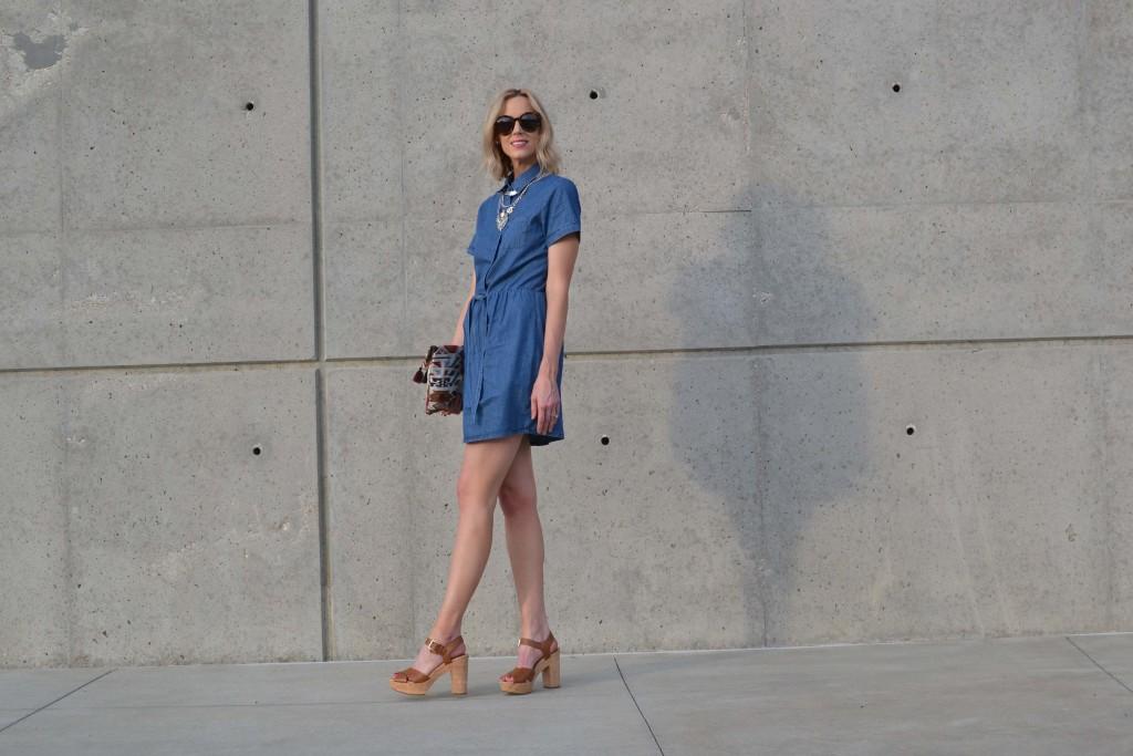 denim dress, fringe clutch, karen walker sunglasses, platforms, silver necklace