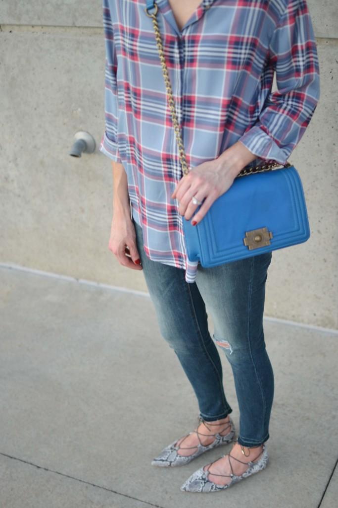 plaid shirt, jeans, snakeskin flats, blue bag