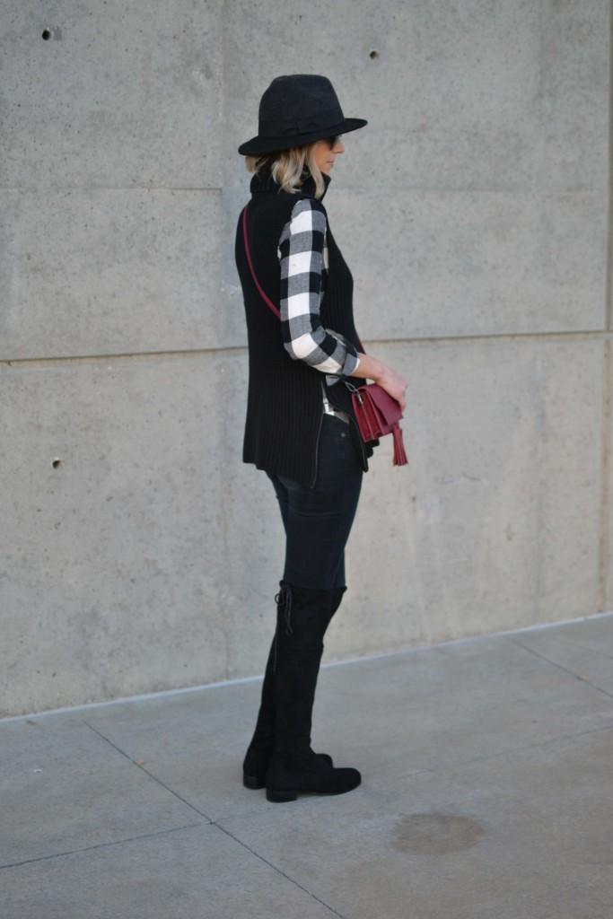 OTK boots, black jeans, hat, plaid shirt