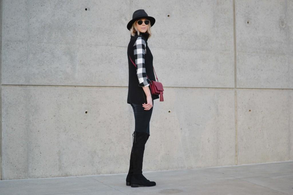 OTK boots, black jeans, plaid shirt, hat