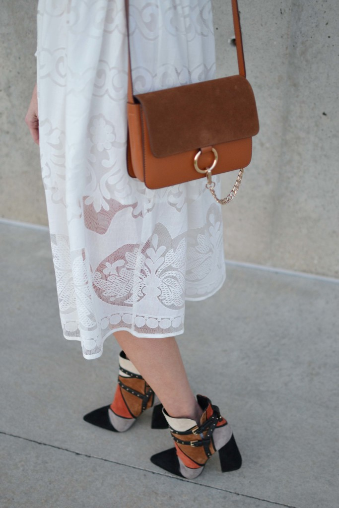 while lace dress, chloe dupe bag, patchwork booties details