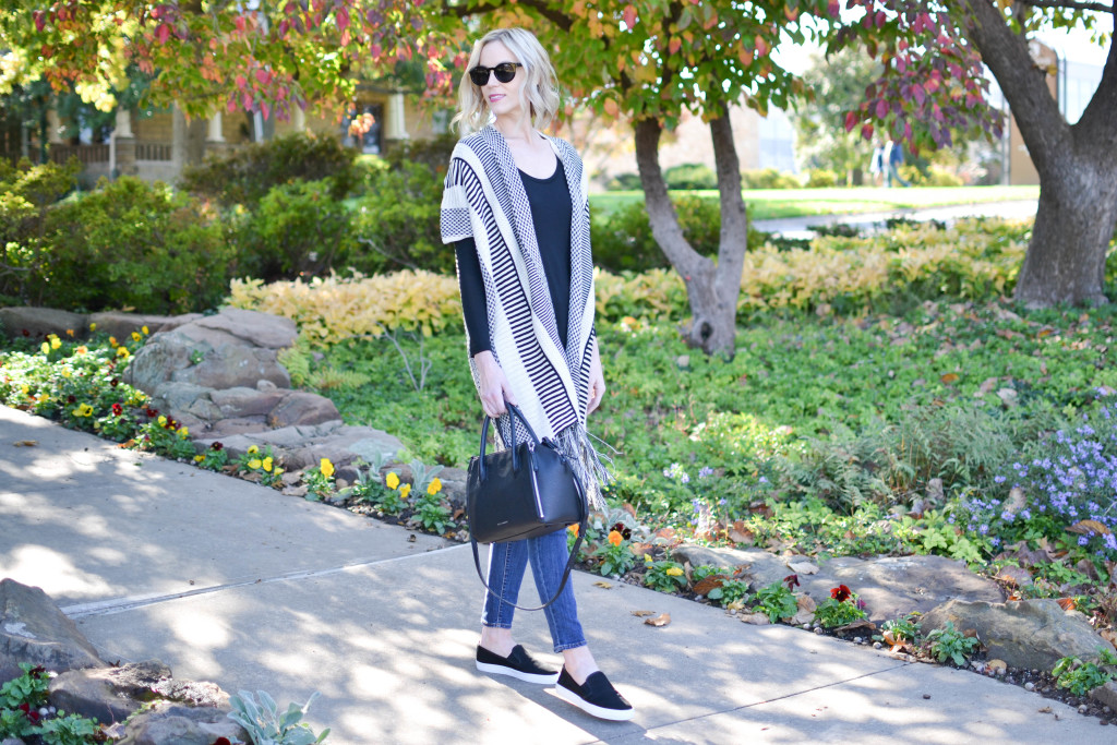 jeans, fringe cardigan, slip on sneakers, black tee, Rebecca Minkoff bag