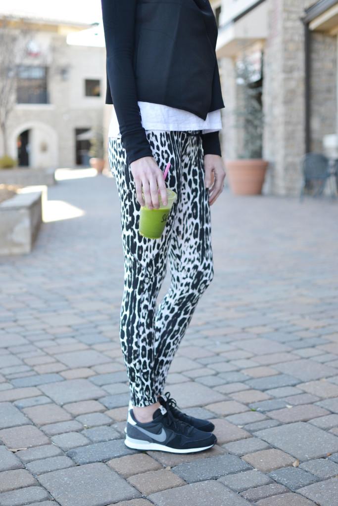 Carbon 38 leopard workout pants and black wrap jacket, Black Nike Internationalist tennis shoes