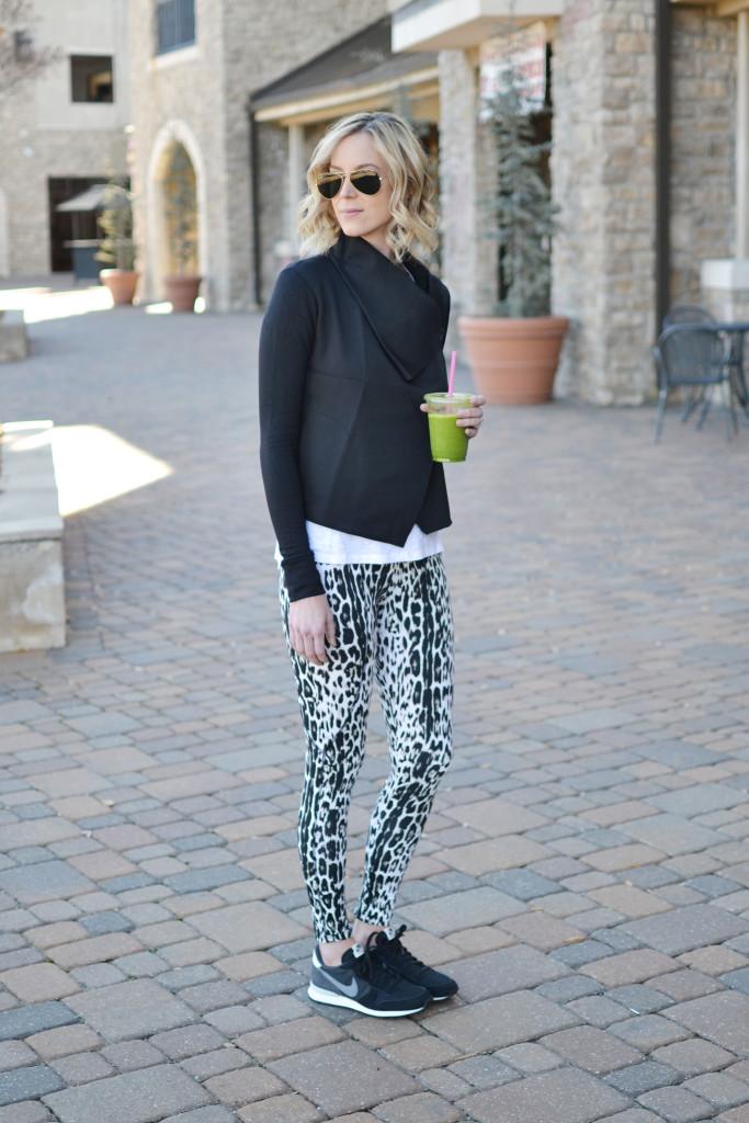 Carbon 38 leopard workout pants and black wrap jacket, Ray-Bans, black Nike Internationalist