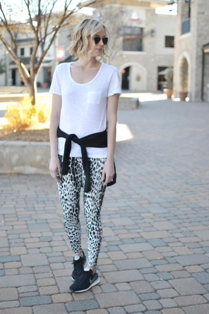 Carbon 38 leopard workout pants and black wrap jacket, white tee, black Internationalist Nikes