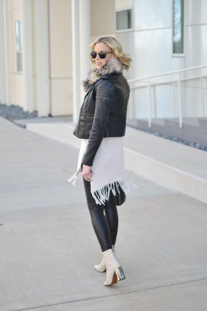 fringe hem tunic sweater, leather jacket, faux fur scarf, leather leggings