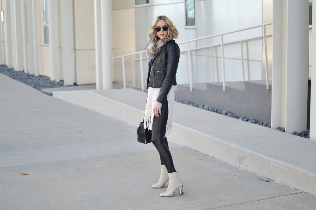 fringe hem tunic sweater, leather jacket, faux fur scarf, leather leggings, cream booties