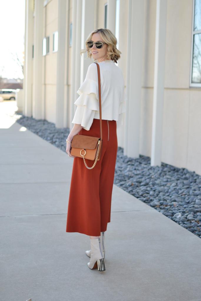 ruffle sleeve shirt, culottes, cream boots, chloe due bag