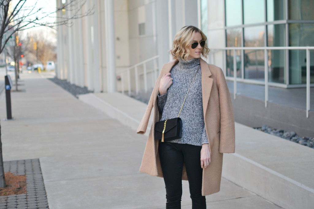 tan coat, grey turtleneck, coated black jeans