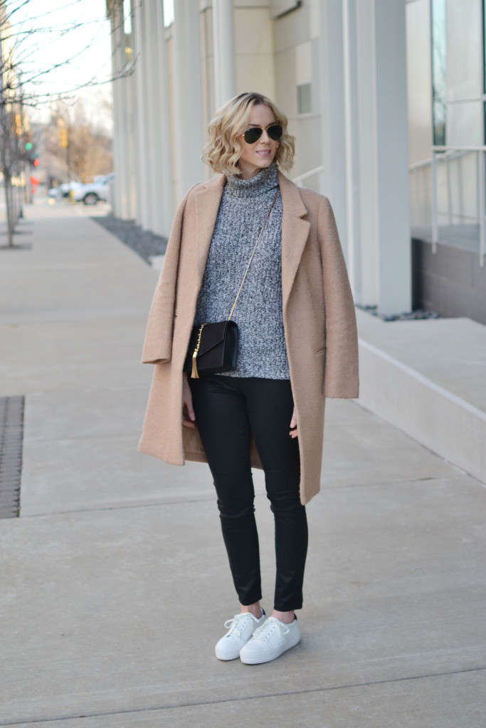 tan coat, grey turtleneck, coated black jeans, black crossbody, white flatform sneakers