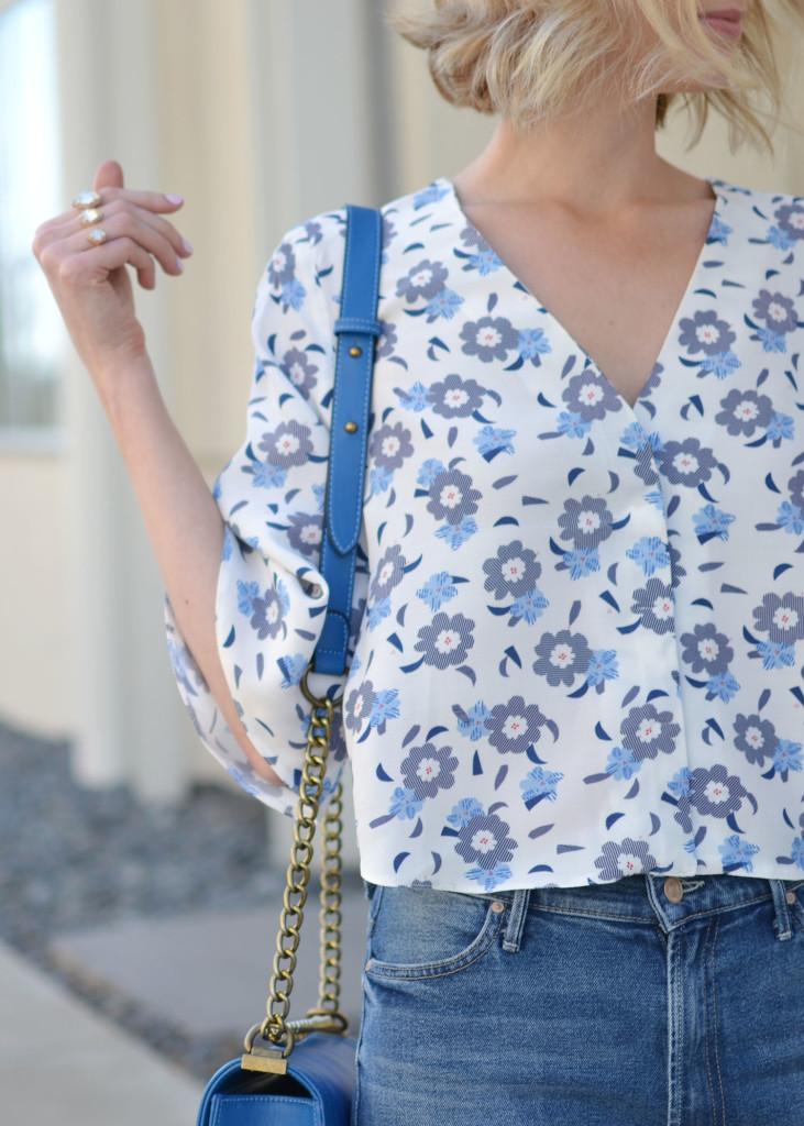 floral top, cropped flares, blue bag, kendra scott ring