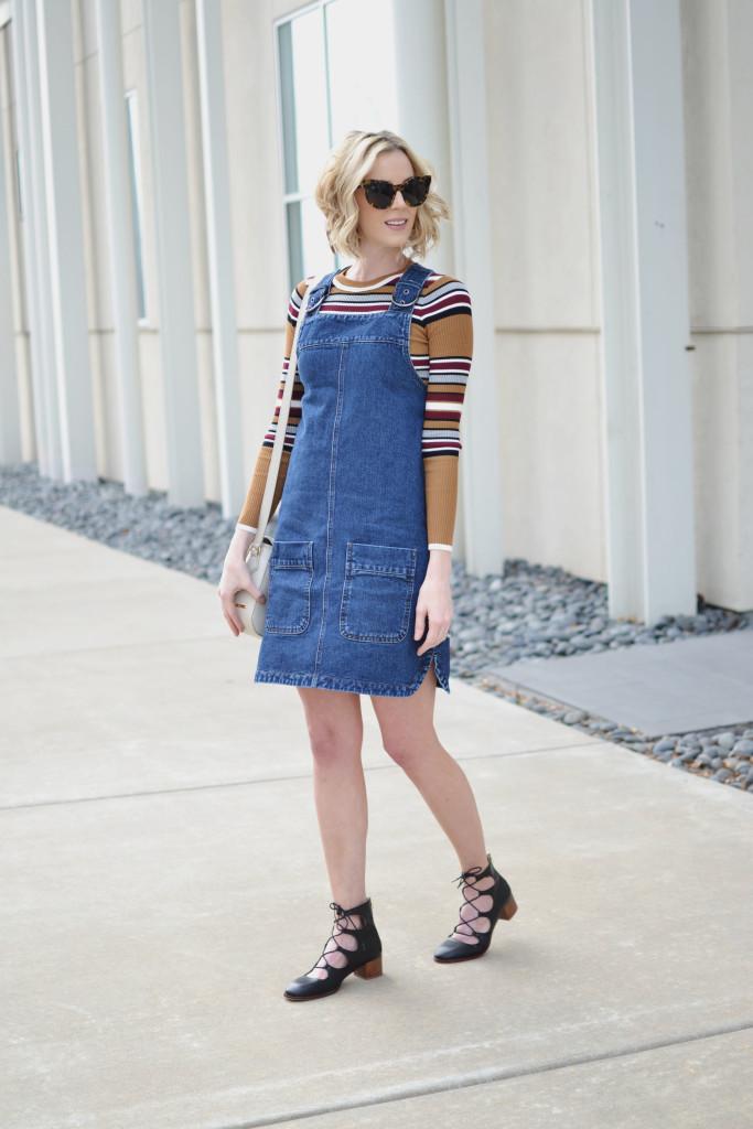 overall dress, striped top, Karen Walker starburst sunglasses, GiGi NY Kelly saddle bag, lace up block heel shoes