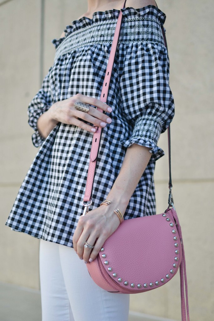 Today I'm styling pieces from the new Kendra Scott summer collection with a gingham off the shoulder top, white jeans, and the cutest pink bag.