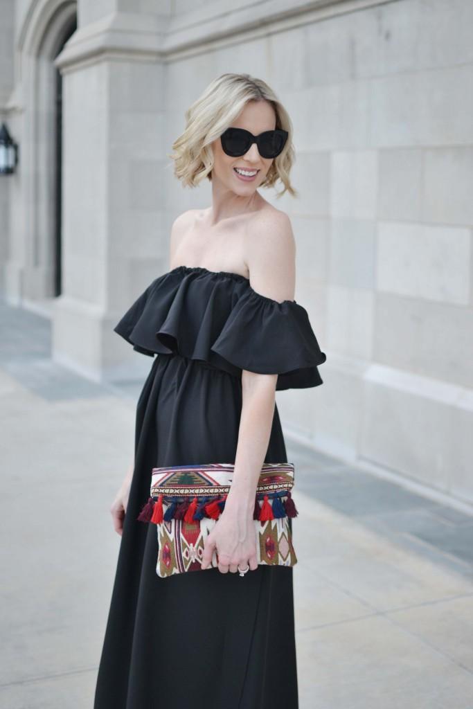 black ruffled off the shoulder midi dress, lace up wedges, tassel clutch