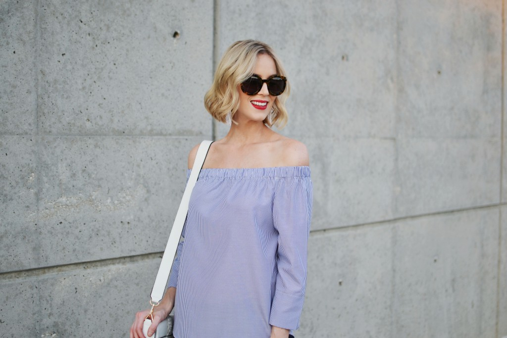 blue and white striped off the shoulder top, white tassel bag