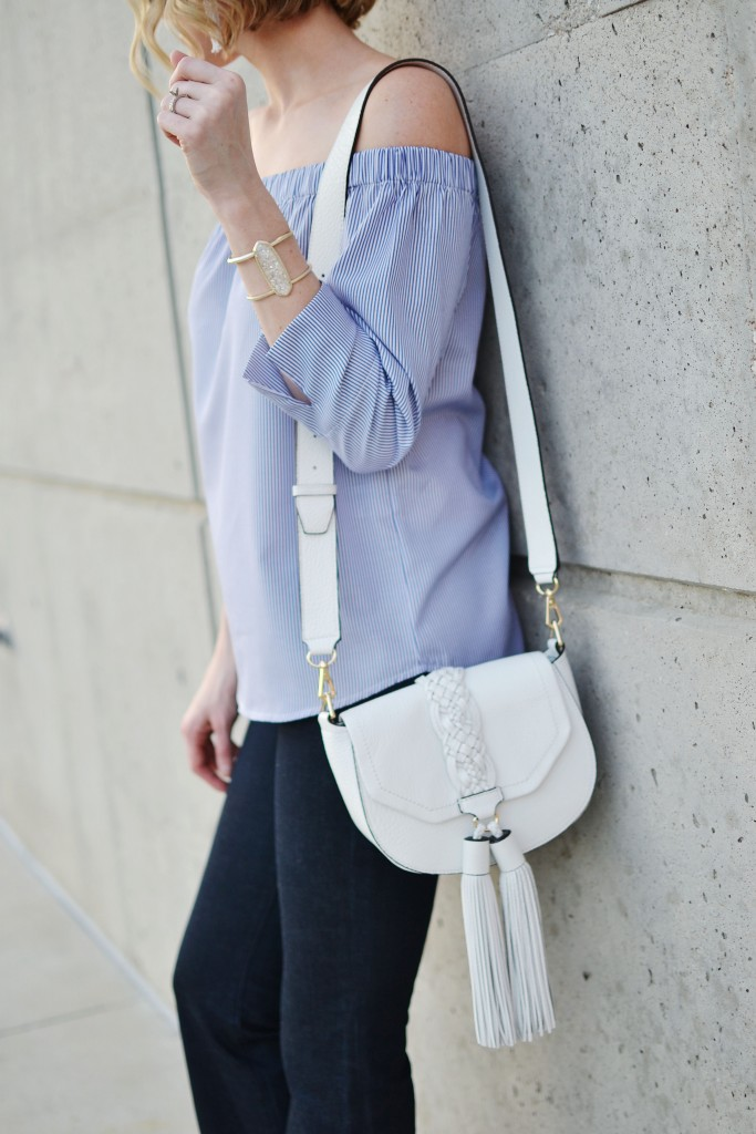 blue and white striped off the shoulder top, white tassel bag, flare jeans