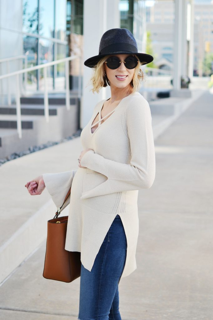 Free People sweater, jeans, Tory Burch tote, hat