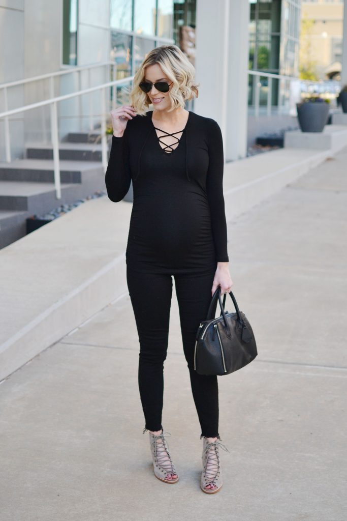 all black outfit, lace up top, black jeans, stylish maternity outfit, fall outfit idea