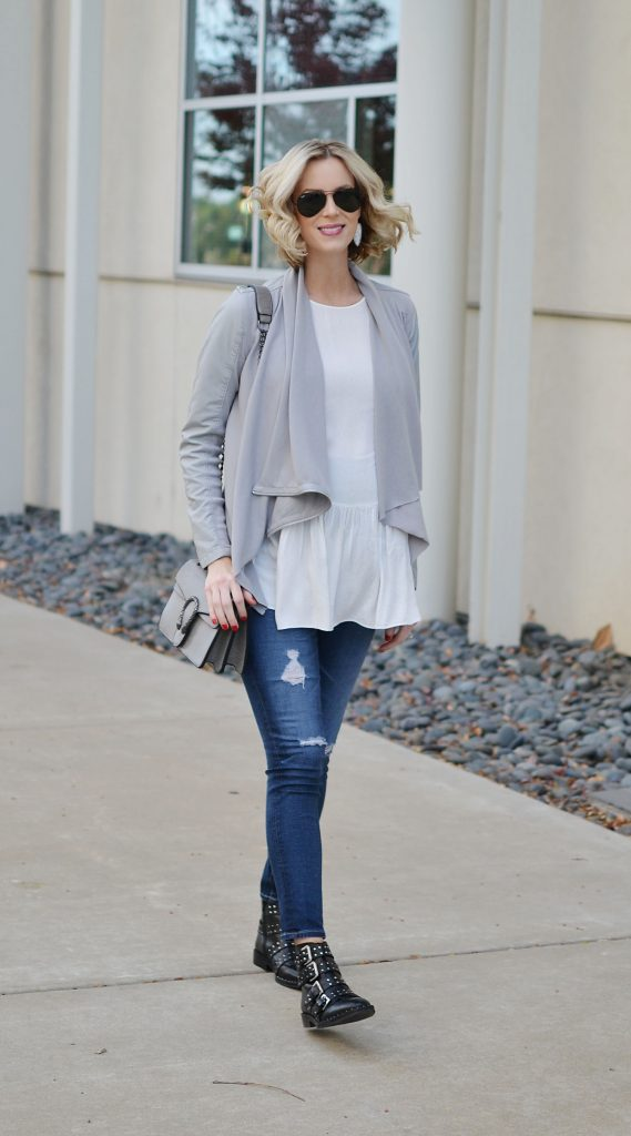 easy casual outfit, draped leather jacket, white blouse, distressed denim, boots, stylish maternity outfit