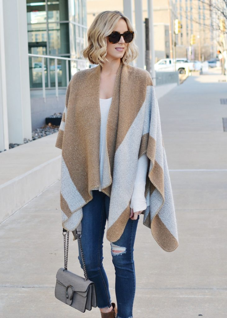 affordable trendy denim, poncho, thermal, distressed denim, boots, casual outfit idea