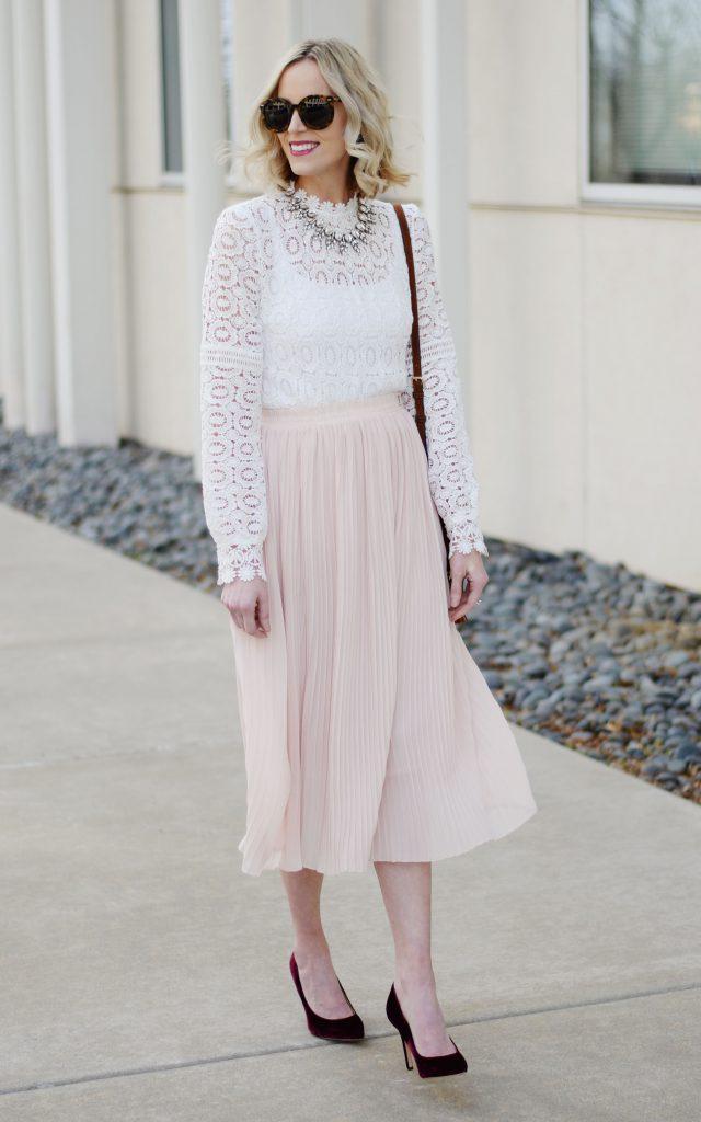 pleated blush midi skirt with white blouse