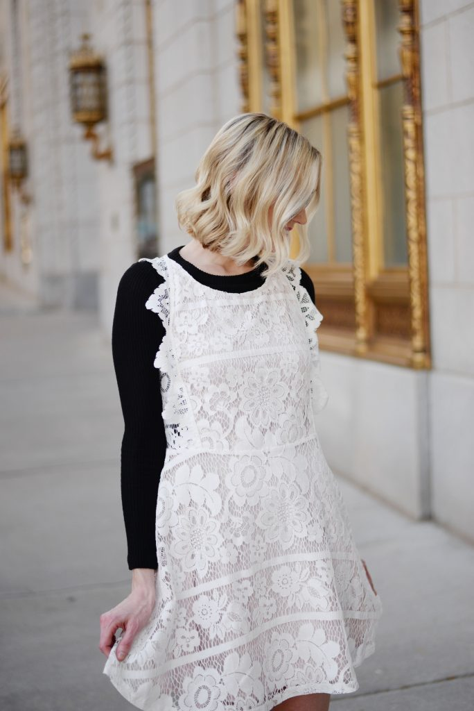 styling a backless dress, backless white lace dress, black tee
