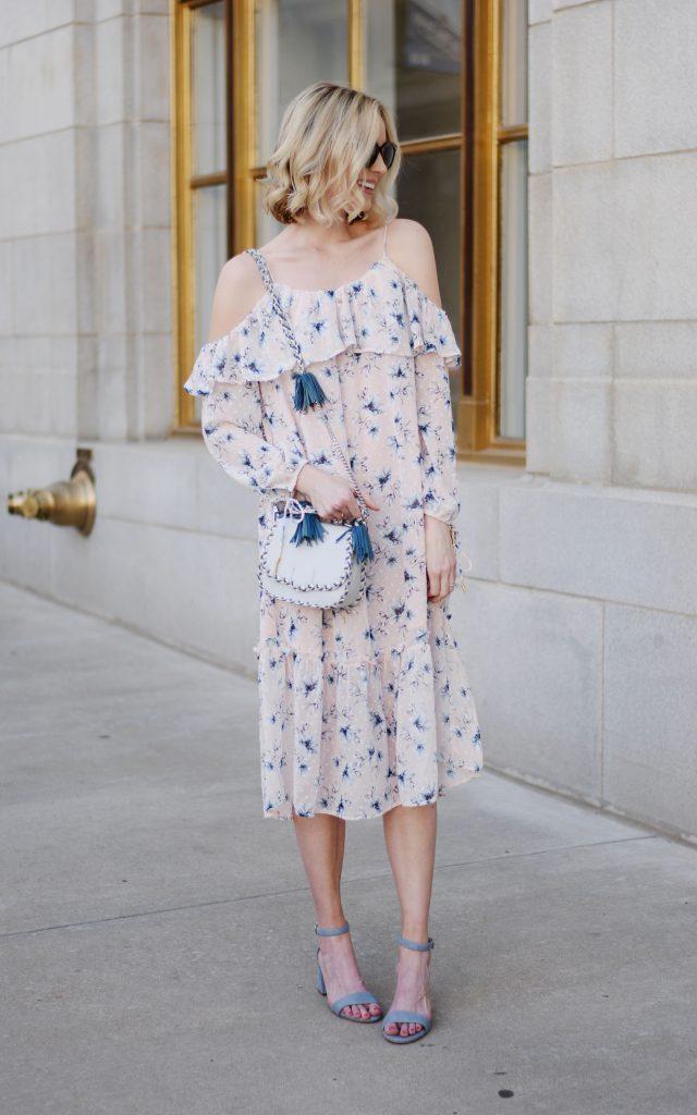 Easter outfit idea, blush off the shoulder floral dress, blue sandals, Rebecca Minoff tassel bag