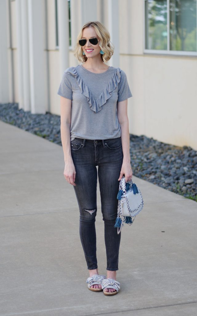 monochrome grey casual outfit with blue Rebecca Minkoff tassel bag and bow slides