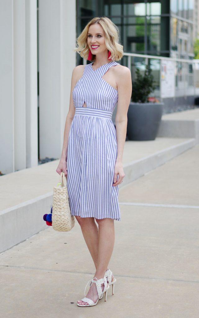 blue and white cutout dress, pink tassel earrings, straw bag, white heels