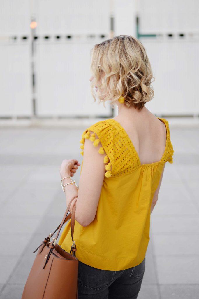 why you shouldn't be afraid of marigold, marigold pom pom top, grey jeans, tan tory burch bag