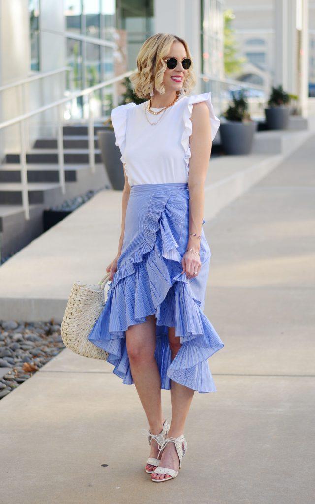 ruffles on ruffles, blue tiered ruffle skirt, white ruffle sleeve top, straw bag, summer outfit