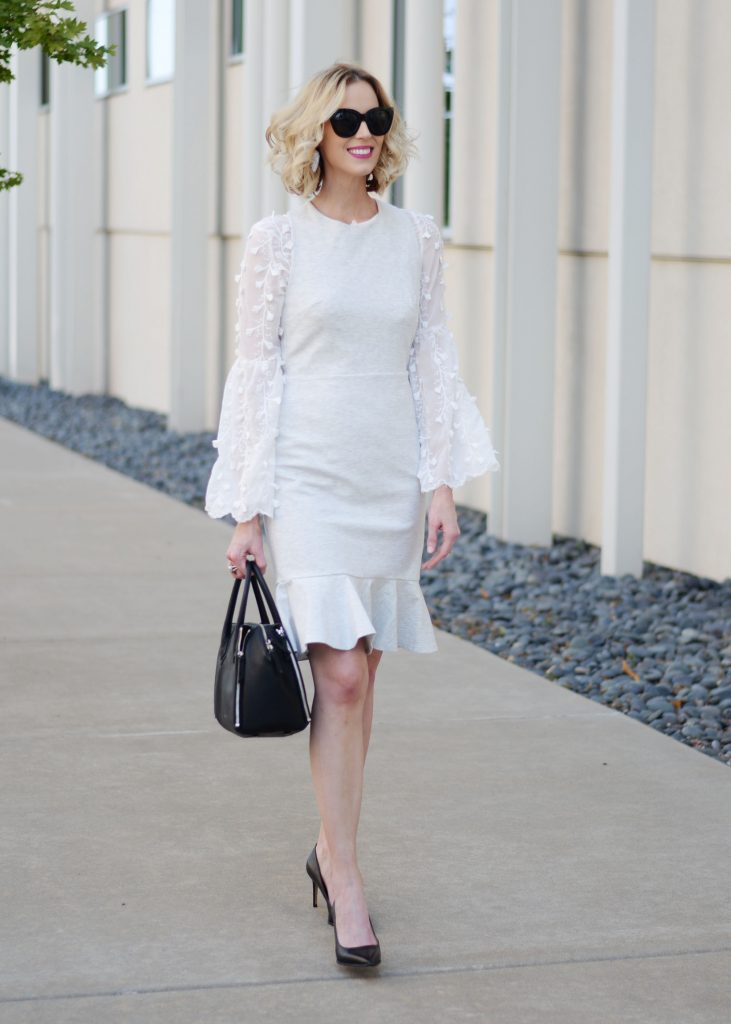 fitted point dress for work, how to style a dress over a blouse for work, work chic look, grey and white, black pumps