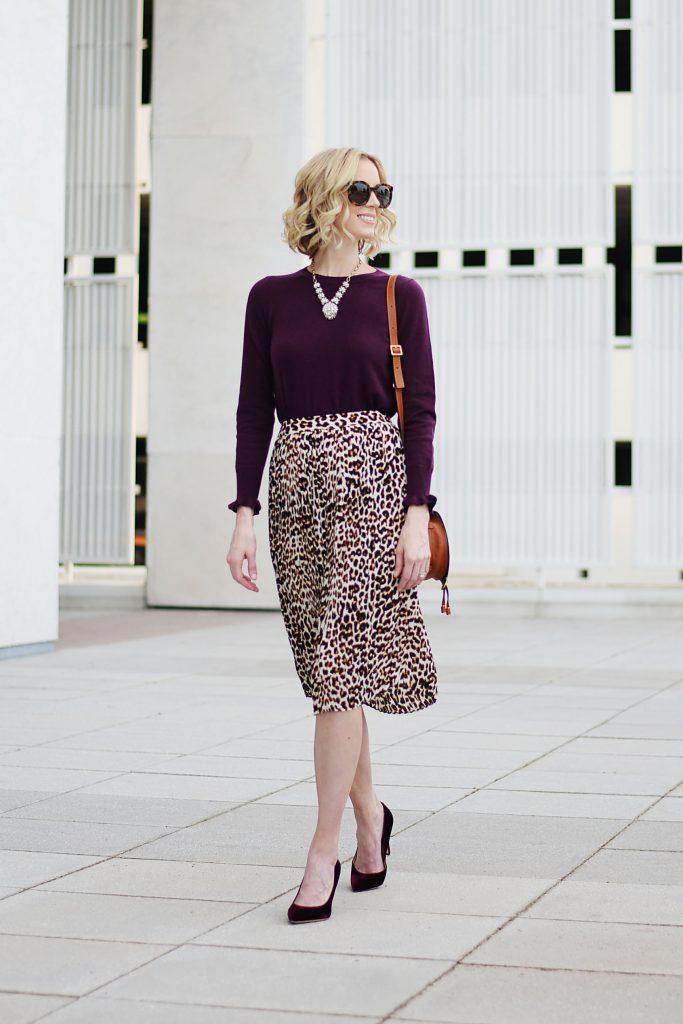 burgundy sweater with ruffle hem sleeves, leopard midi skirt, burgundy velvet heels, fall work outfit idea