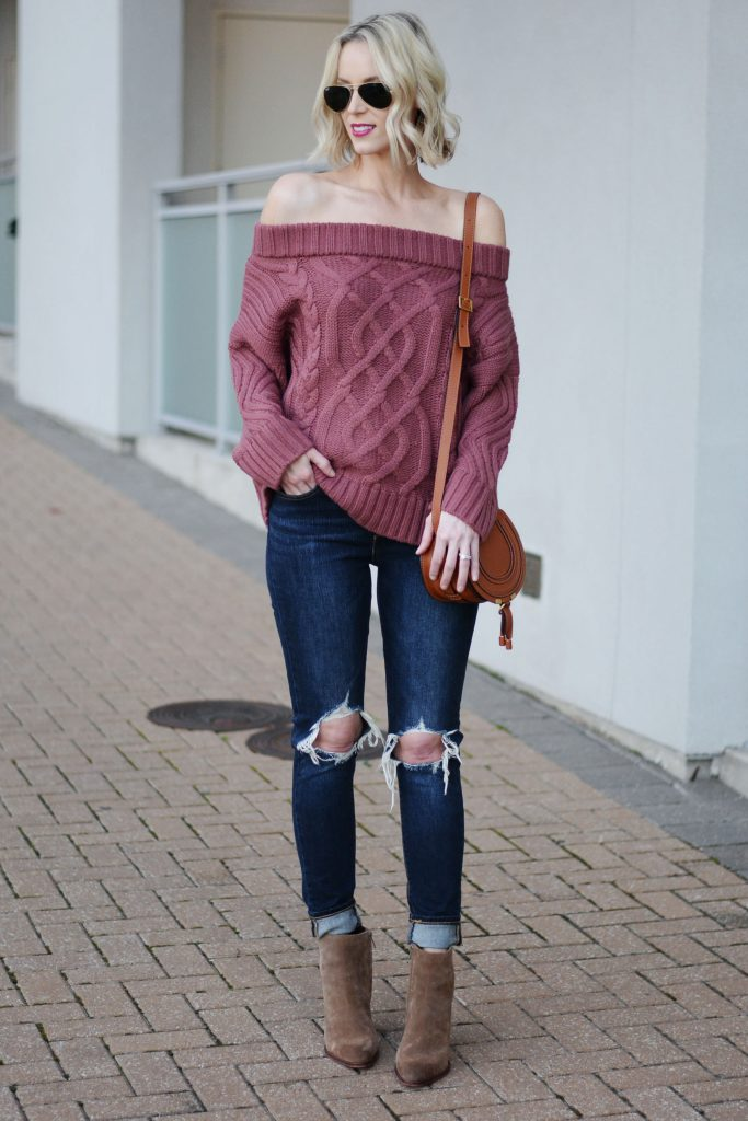 off the shoulder burgundy sweater with distressed jeans and boots