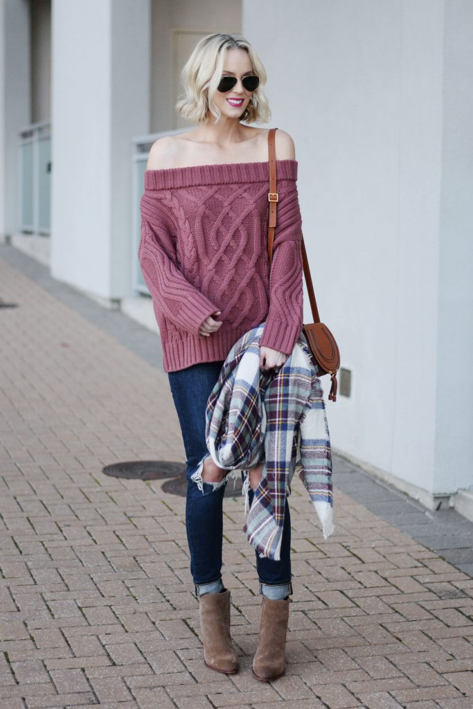easy fall outfit idea, chunky sweater with distressed jeans and boots, blanket scarf