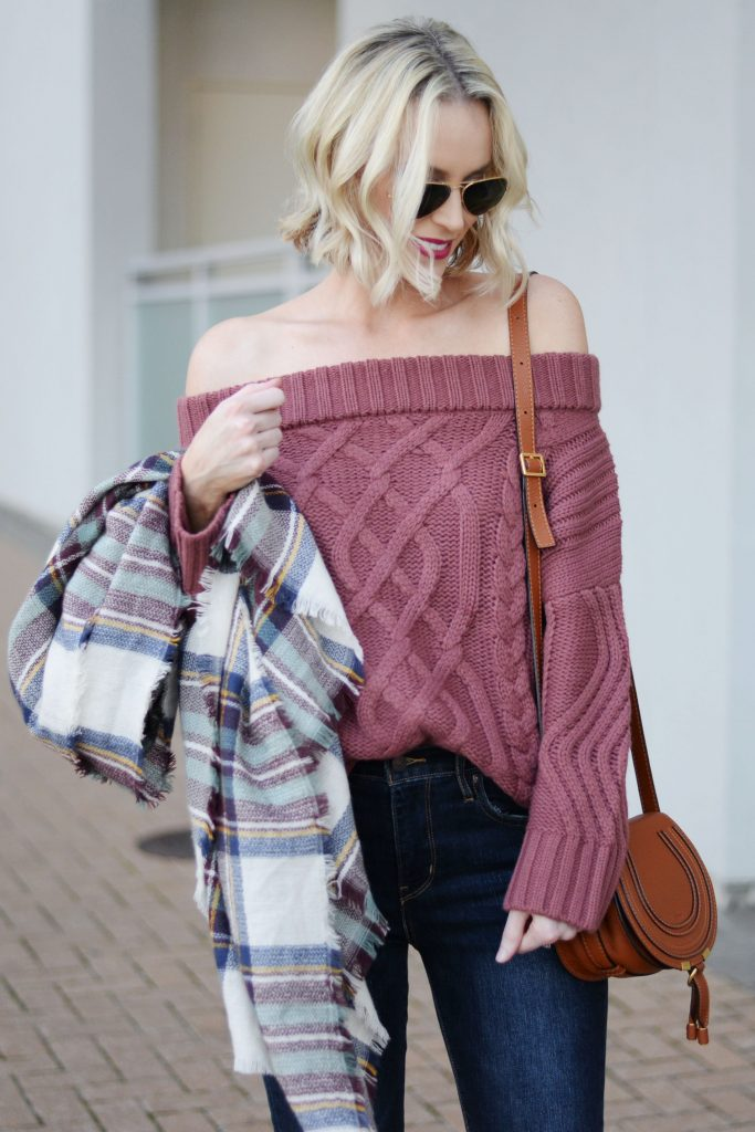 berry off the shoulder sweater with dark jeans, plaid blanket scarf, aviators, blonde wavy bob