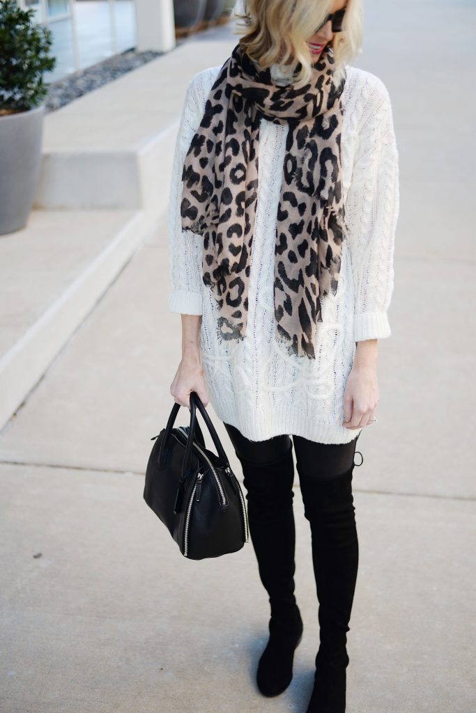 cream tunic sweater with leather leggings and over the knee boots