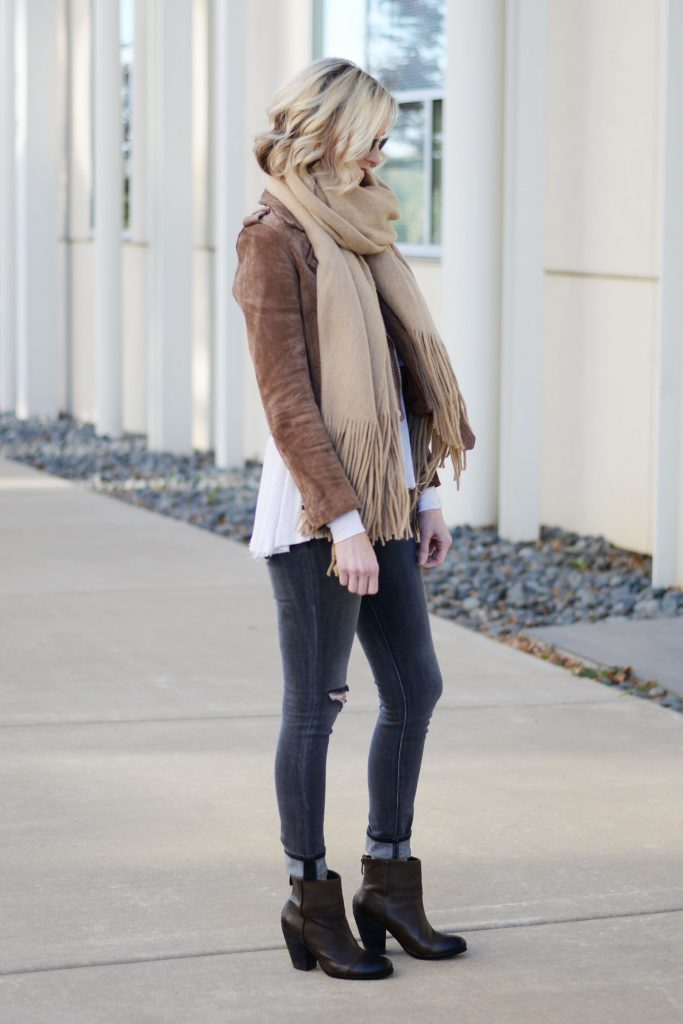 suede moto jacket layered of thermal with jeans and booties