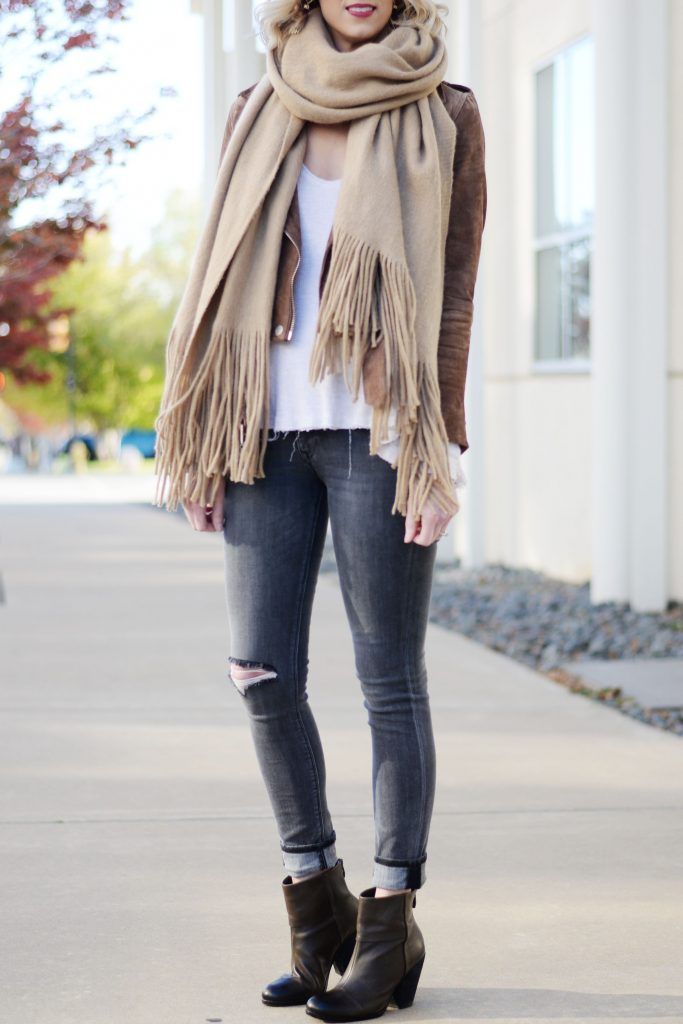 neutral fall layered look, taupes, creams, and greys together, moto jacket, jeans, and scarf