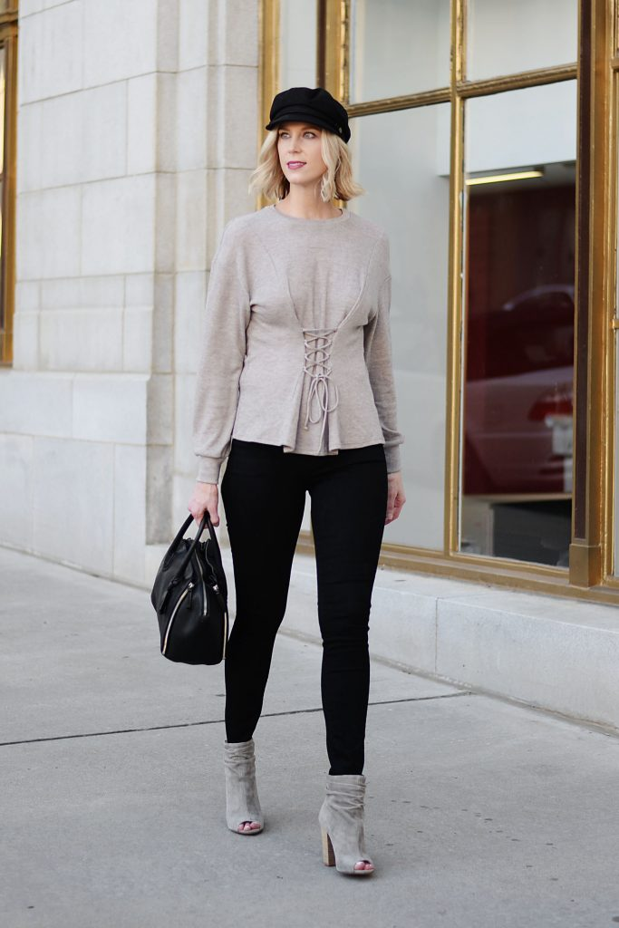 corset style top with back jeans and booties, baker boy hat