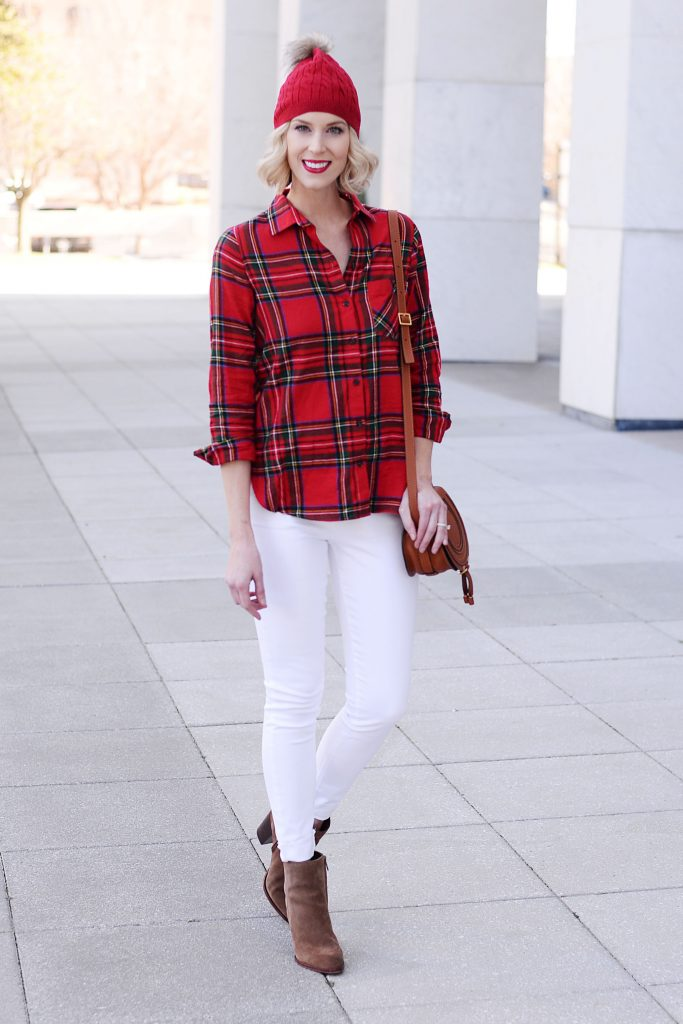 red plaid shirt with white jeans and brown ankle booties, red beanie