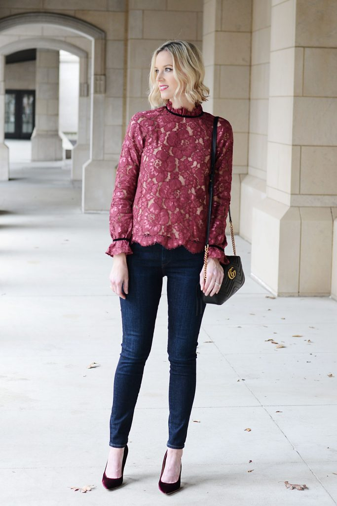 berry colored ace blouse with velvet trim detailing and classic skinny jeans