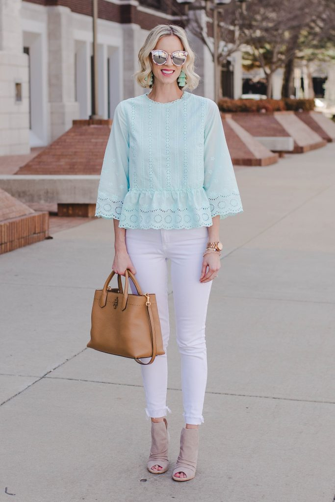 mirrored sunglasses, matching mint top and earrings, white jeans, nude booties