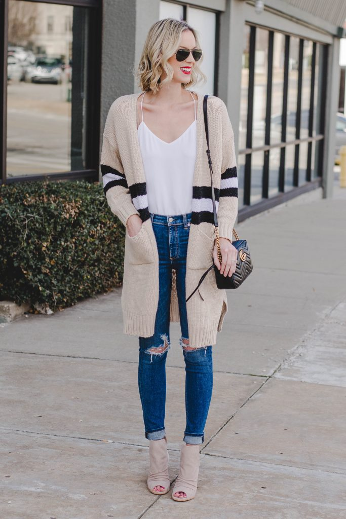 the cardigan that goes with everything, tan cardigan with black and white stripe