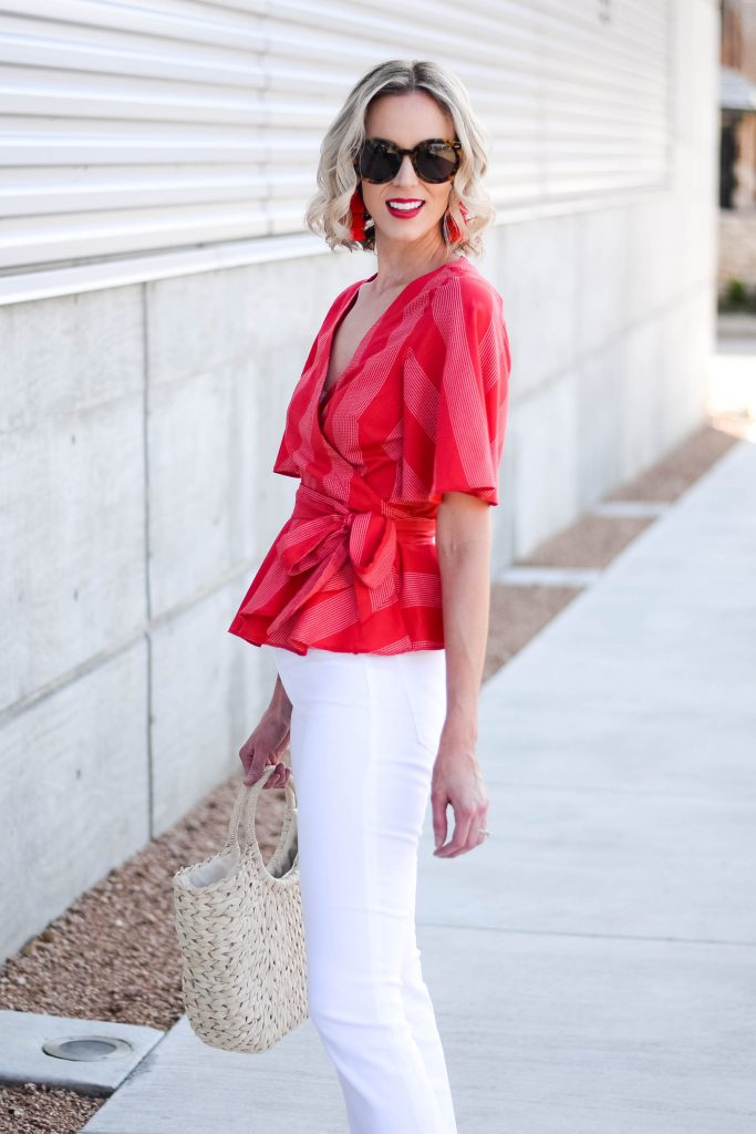 pair your white jeans with a red top for a gorgeous and bold color combo